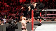 Rollins and Ambrose launch themselves onto Sheamus and Cesaro