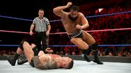 Rusev giving an elbow drop on Orton
