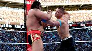 Cena punches Rusev