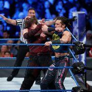 Fandango strike with an elbow on Harper