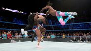 Kofi and Big-E delivering the Usos a Midnight Hour