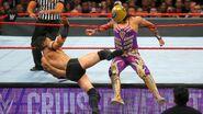 Neville deliver a kick onto Gran-Metalik