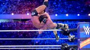 Rollins suplexes Triple-H off the turnbuckle