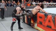 Owens powerbomb Rollins