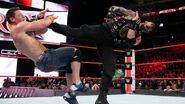 Reigns kick Cena