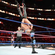 Mahal suplex Nakamura onto the mat