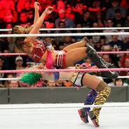Asuka takes down Emma with a massive suplex
