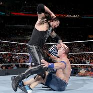 Corbin punches Cena