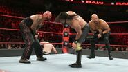 Rollins kick both Anderson and Gallows