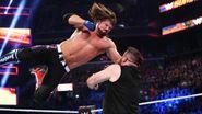 AJ-Styles aimed the phanomenal forarm at Owens