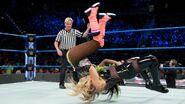 Natalya suplex Naomi