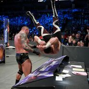 Orton drops Zayn onto the announce table
