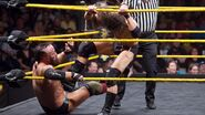Eric-Young stompin in the corner from Adam-Cole