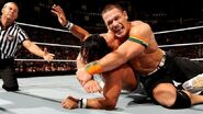 Cena putting Rollins in submission