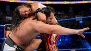 Nakamura holding down on Rusev