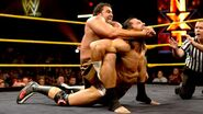 Alexander-Rusev putting Ryan in submission