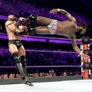 Rich Swann drop kicking Neville
