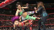 Sasha and Bayley dropkick Jax