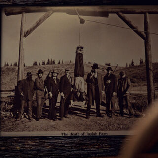 The Seven with Josiah Earp in a frame in the Judges office