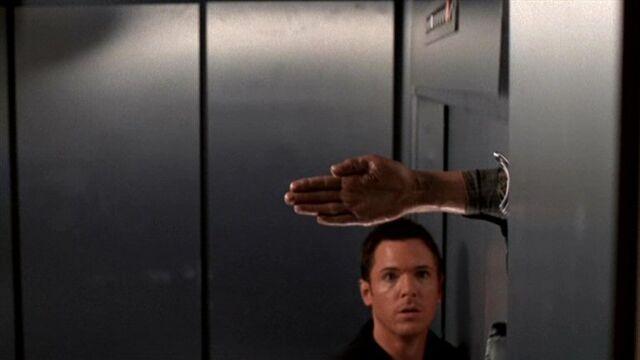 File:Billy Miles' hand cuts through elevator door.jpg