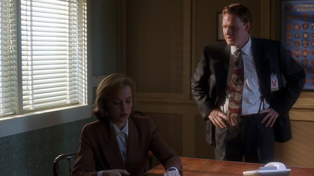 File:Tom Colton voices frustration with Dana Scully.jpg