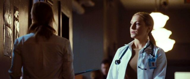 File:Doctor's Colleague passes Dana Scully.jpg