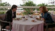 Tom Colton and Dana Scully at table