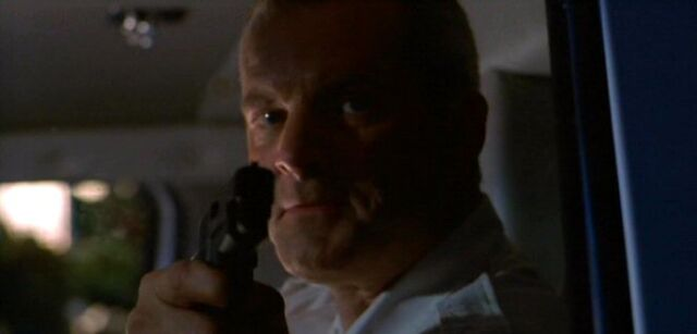 File:Black-Haired Man shoots Fox Mulder.jpg