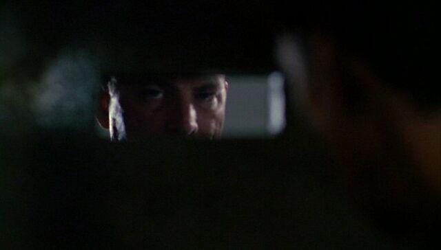 File:Black-Haired Man peering through slot.jpg