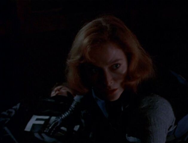 File:Dana Scully is surprised while tending to Fox Mulder.jpg