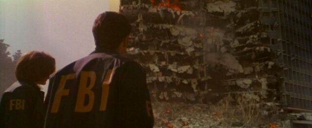 File:Fox Mulder and Dana Scully survey bomb damage.jpg