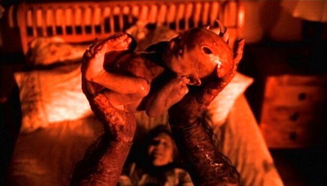 File:Demonic baby held by vele.jpg