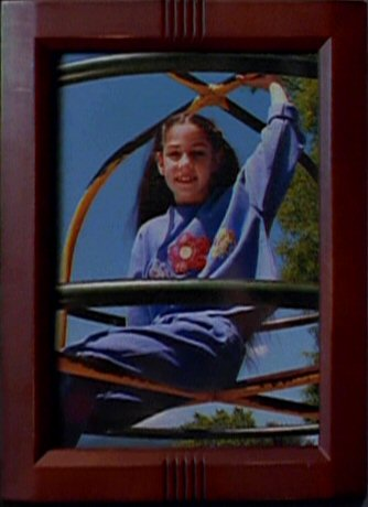 File:Samantha Mulder photographed on climbing frame.jpg