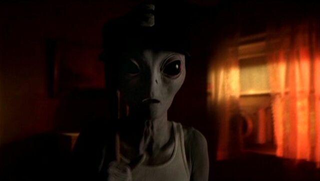 File:Grey alien with baseball paraphernalia.jpg