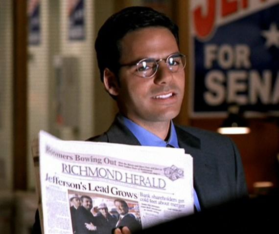 File:Jock Busfield holding newspaper.jpg