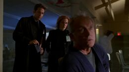 Frank Black is visited by Fox Mulder and Dana Scully