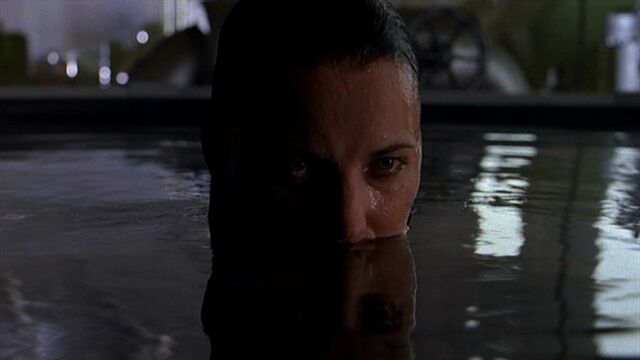 File:Shannon McMahon hides in water.jpg