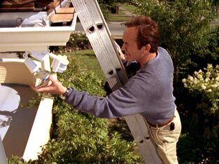 Frank Black installs security light