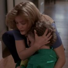 Trent held by Scully