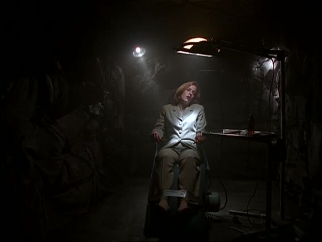 File:Scully strapped to a chair.jpg
