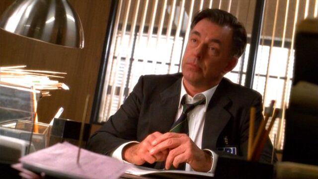 File:Russel in office.jpg