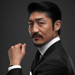 Ministre Noburo Mori (Brian Tee)