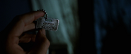 Logan holds his Wolverine Dog Tag (X2 - 2003)