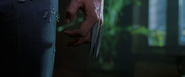 Logan retracting his claws (X2 - 2003)