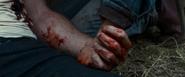 Logan holds Laura's hand