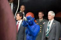 Mystique points the gun at Magneto