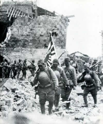 Japanese-troops-in-rubble-of-village