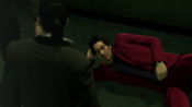 Majima wakes Nishitani after slamming his back with Majima's right foot