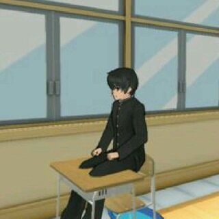 Senpai sitting on his desk