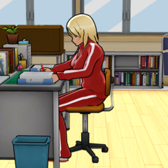 Kyoshi doing work at her desk in the Faculty Room.